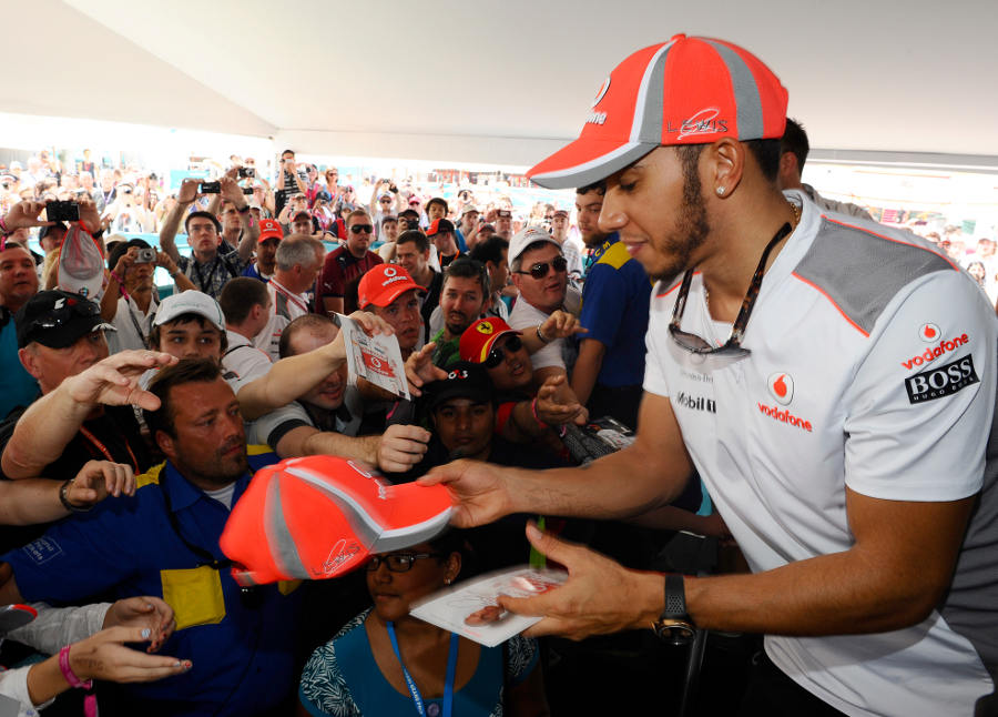 Lewis Hamilton signs autographs on Saturday morning