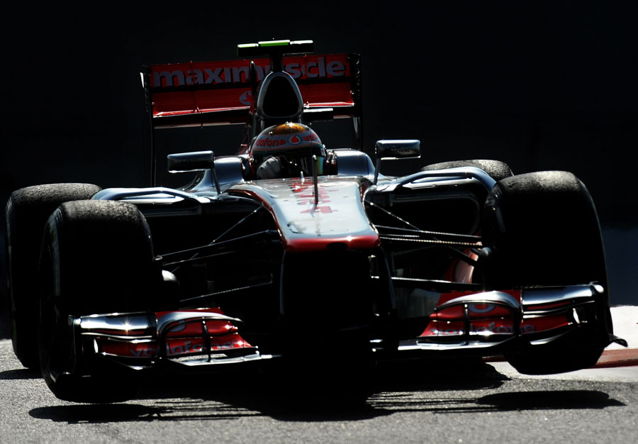 Lewis Hamilton skips over the kerbs in his McLaren
