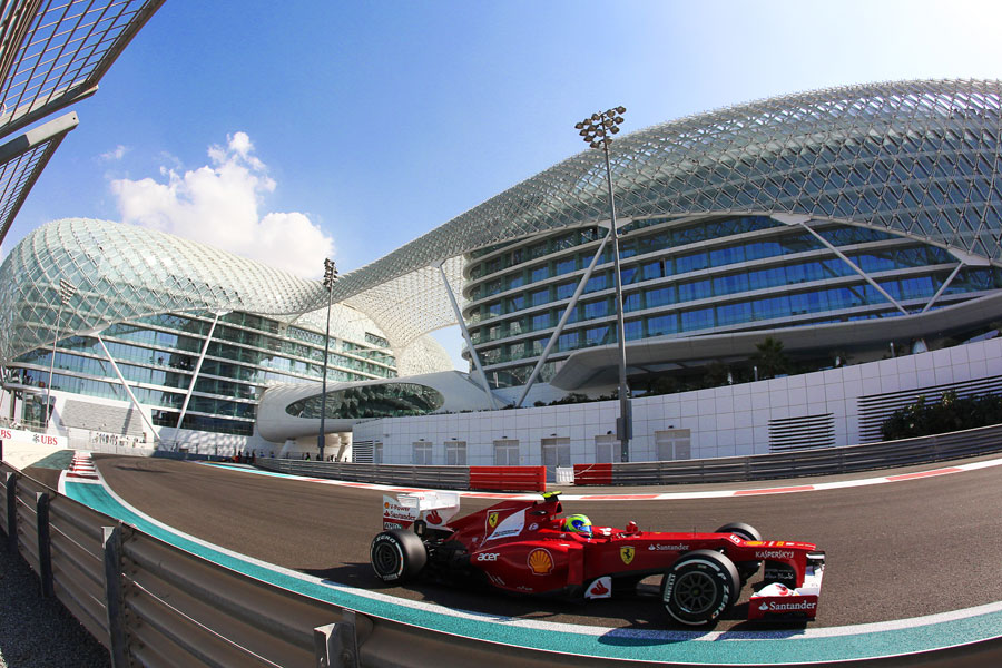 Felipe Massa passes the Yas Hotel