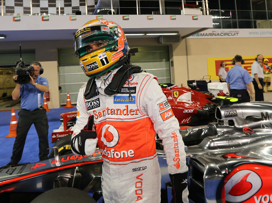Lewis Hamilton steps out of his McLaren after taking pole position