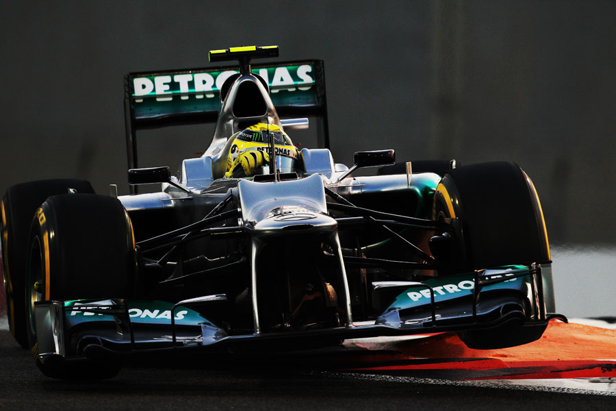 Nico Rosberg skips over the kerbs in his Mercedes