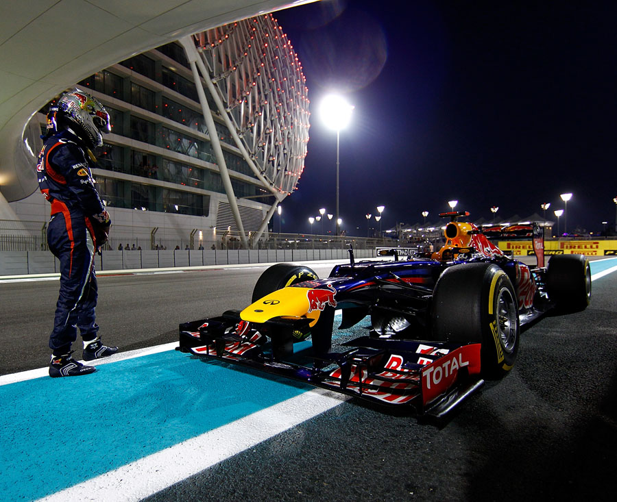 Sebastian Vettel stands by his stricken Red Bull after it race out of fuel in Q3