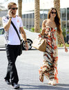 Jenson Button arrives in the paddock with Jessica Michibata