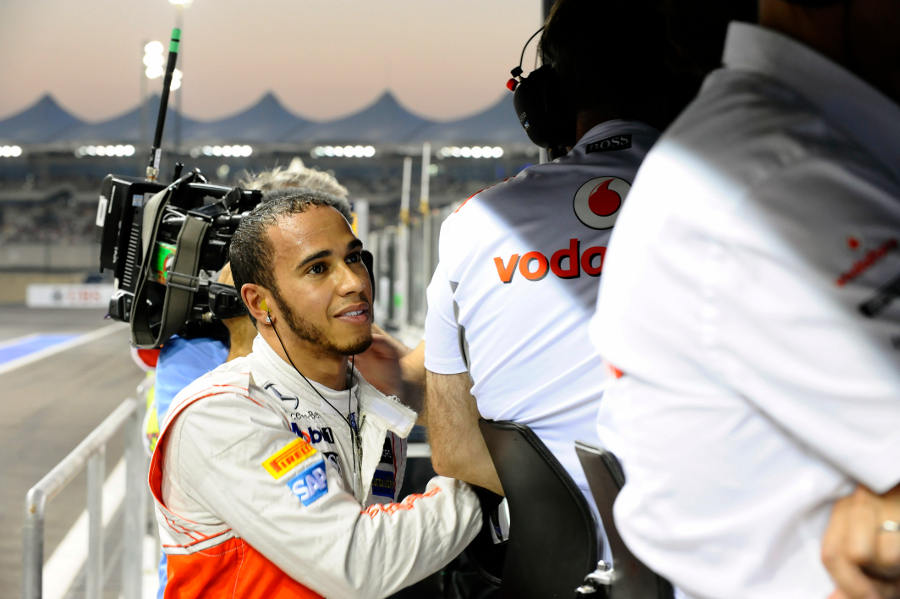 Lewis Hamilton on the McLaren pit wall after his retirement