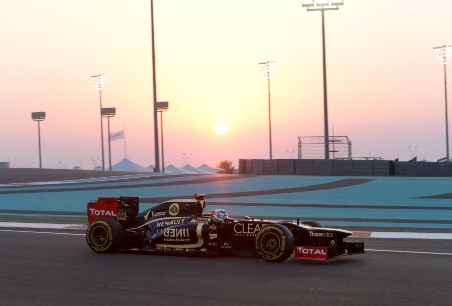 Kimi Raikkonen leads as the sun sets