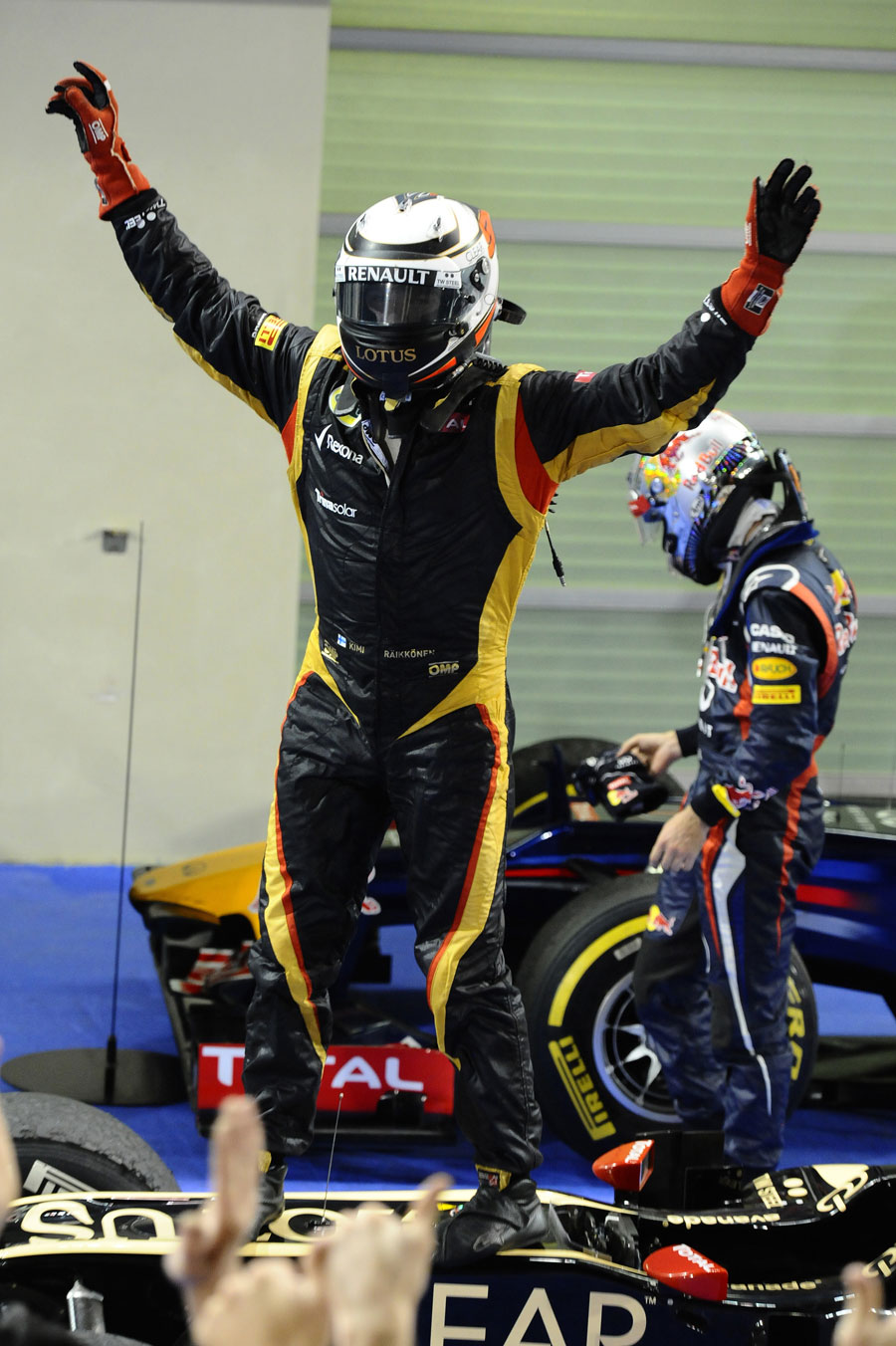 Kimi Raikkonen celebrates on top of his Lotus