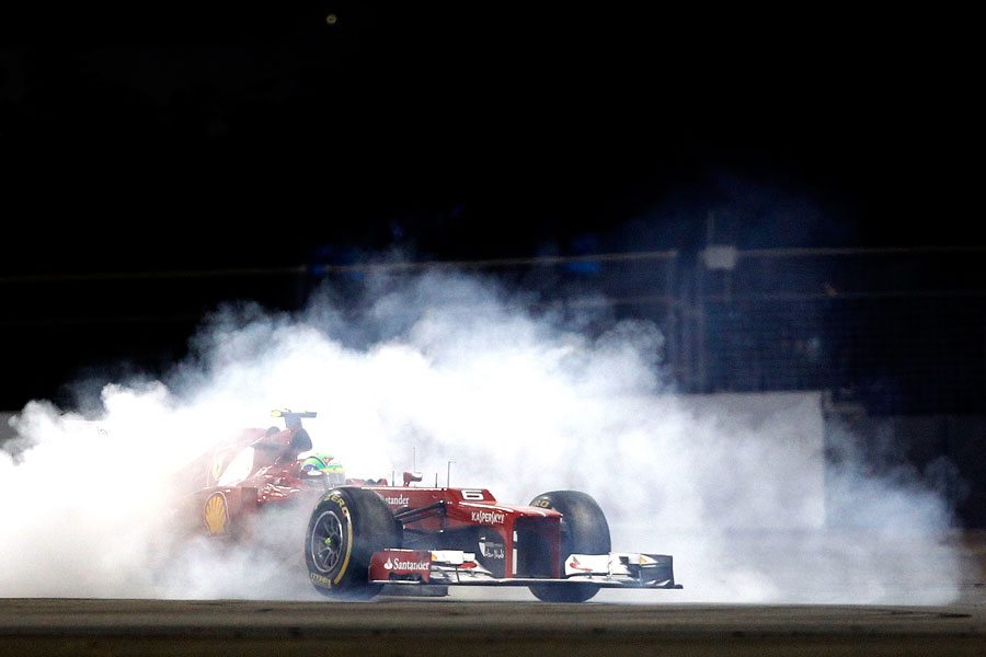 Felipe Massa points his Ferrari in the right direction after being tipped into a spin by Mark Webber
