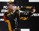 Kimi Raikkonen celebrates in traditional style on the podium