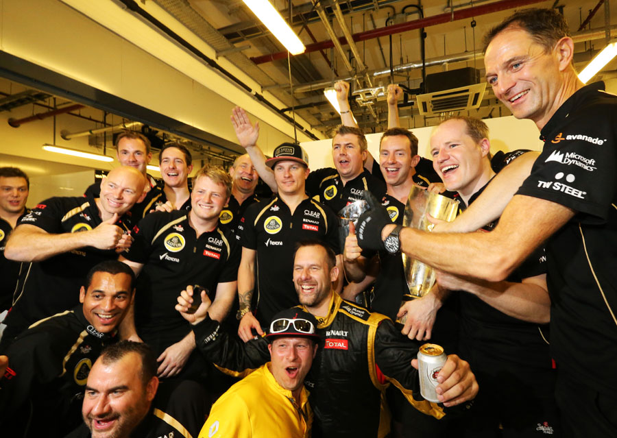 Kimi Raikkonen and his Lotus team celebrate victory