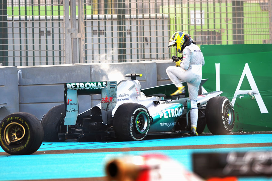 Nico Rosberg climbs out of his wrecked Mercedes