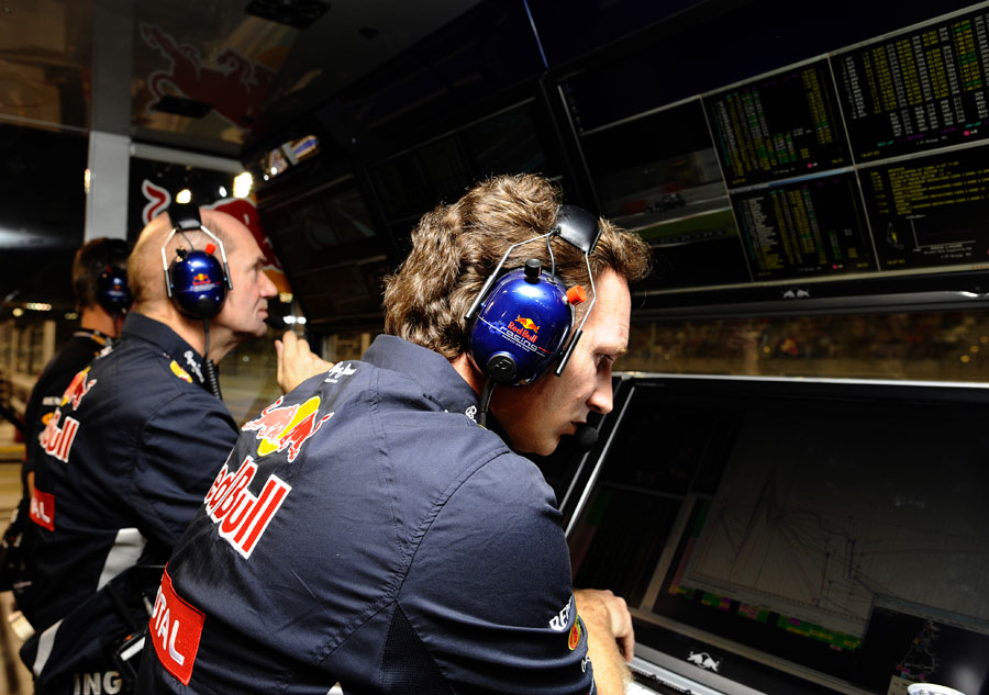 The Red Bull pit wall monitors Sebastian Vettel's progress through the field