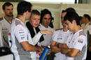 Kevin Magnussen talks to Gary Paffett and the McLaren engineers