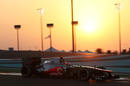 Jenson Button as the sun sets during FP2