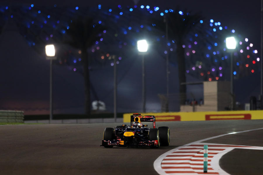 Sebastian Vettel attacks the first sector as the Yas Hotel changes colour