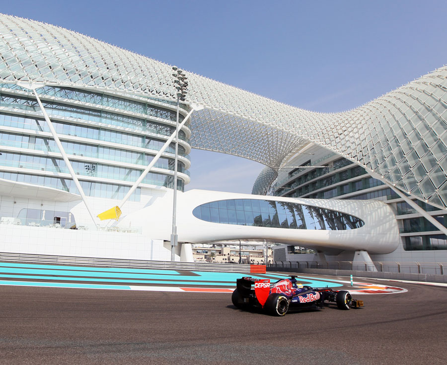 Luiz Razia passes the Yas Hotel in the Toro Rosso