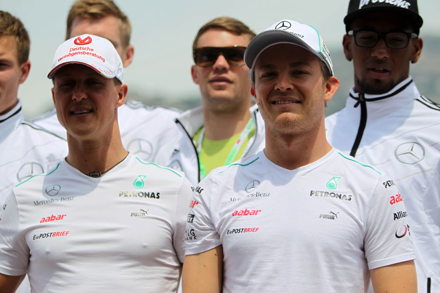 Michael Schumacher and Nico Rosberg pose for a photo