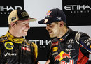 Kimi Raikkonen and Sebastian Vettel share a joke on the podium