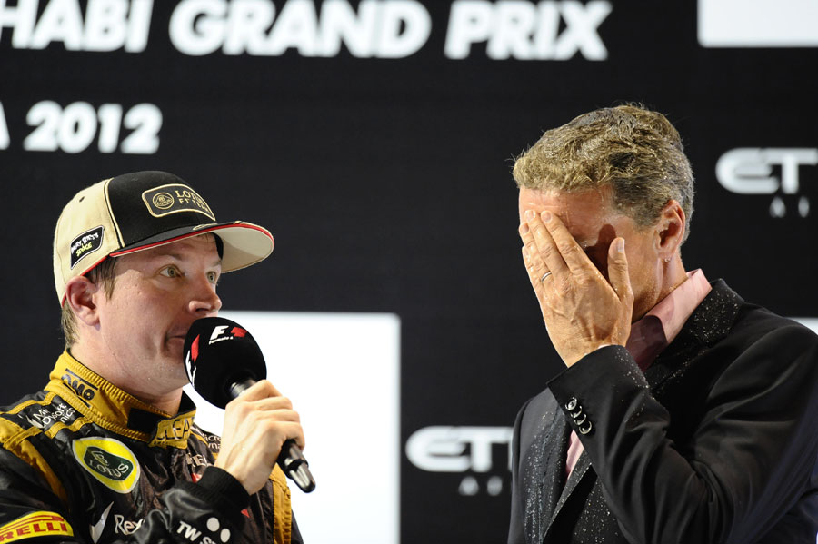 Kimi Raikkonen speaks to David Coulthard on the podium