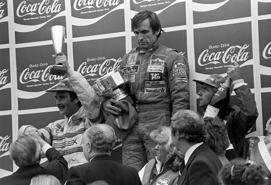 Carlos Reutemann in sombre mood on the podium