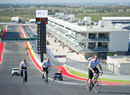 Cyclists climb up the hill to the first corner of the Circuit of The Americas