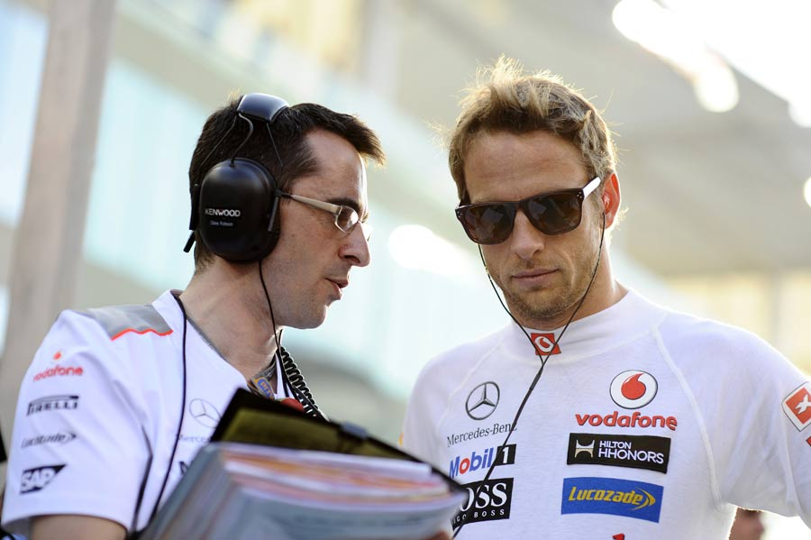 Jenson Button speak to his race engineer in Abu Dhabi
