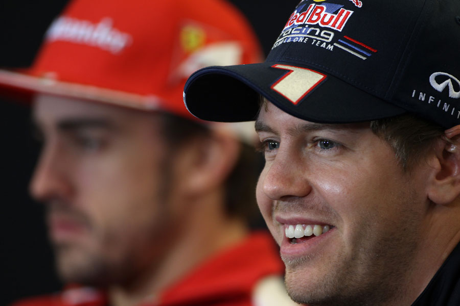 Sebastian Vettel speaks to the media during the driver press conference