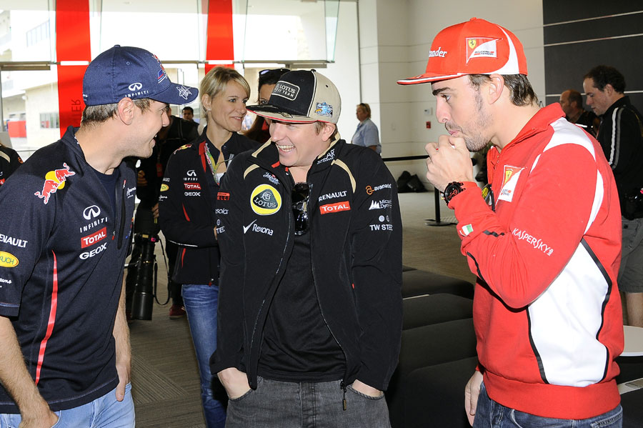 Sebastian Vettel, Kimi Raikkonen and Fernando Alonso joke outside the media centre