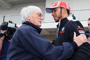 Lewis Hamilton and Bernie Ecclestone chat in the paddock