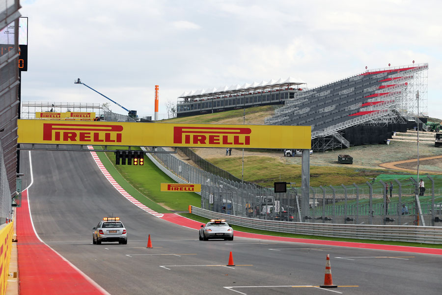 The medical car and safety car race towards turn one