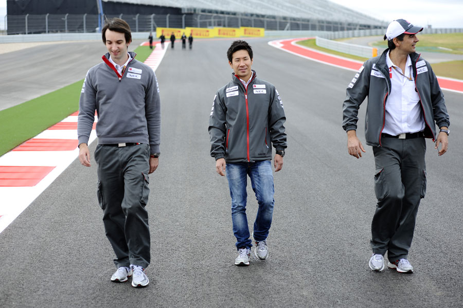 Kamui Kobayashi walks the track with his engineer