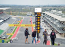 Sebastian Vettel climbs towards turn one on a track walk