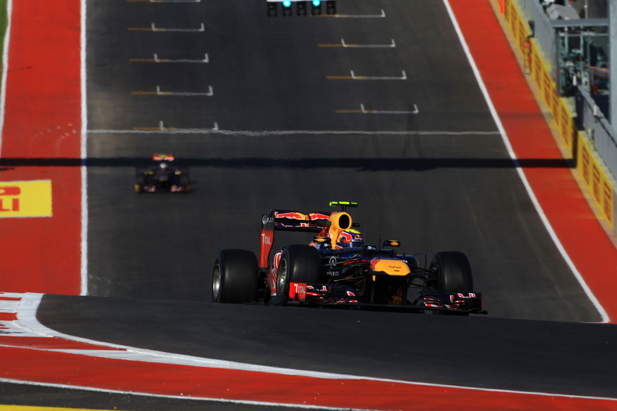 Mark Webber aims for the turn one apex