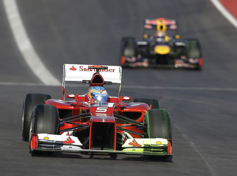 Fernando Alonso leads Sebastian Vettel on track