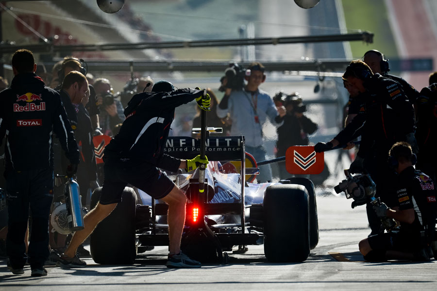Mark Webber hits his marks for a practice pit stop