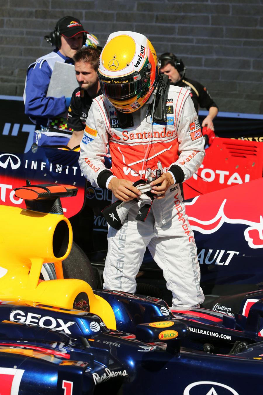 Lewis Hamilton inspects Sebastian Vettel's Red Bull in parc ferme