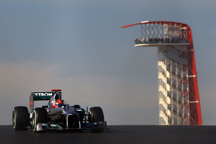 Michael Schumacher crests a hill with the observation tower in the background