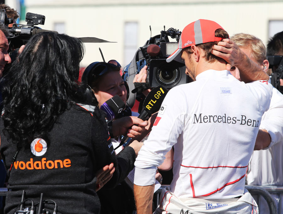 Jenson Button speaks to the press after dropping out of qualifying in Q2