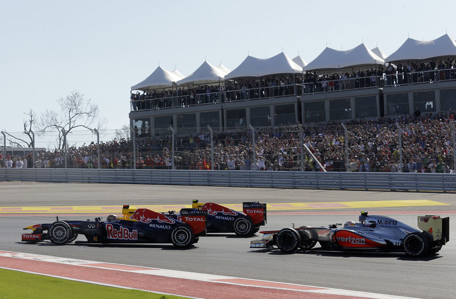 Sebastian Vettel leads Mark Webber and Lewis Hamilton in to the first corner