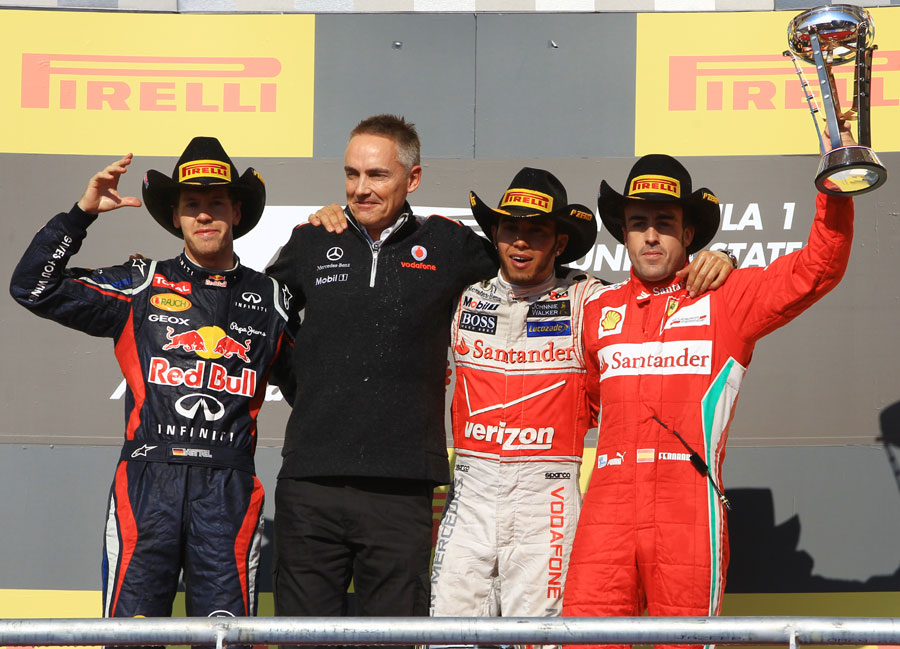 Sebastian Vettel, Martin Whitmarsh, Lewis Hamilton and Fernando Alonso on the podium
