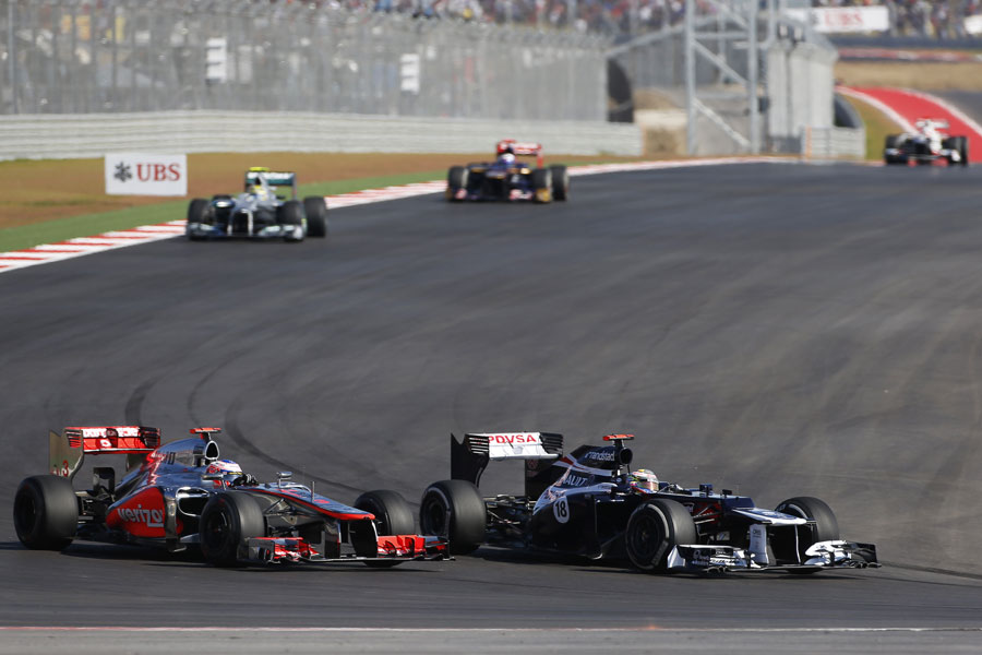 Jenson Button attacks Pastor Maldonado in to turn 12