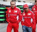 Stefano Domenicali and Felipe Massa walk through the paddock