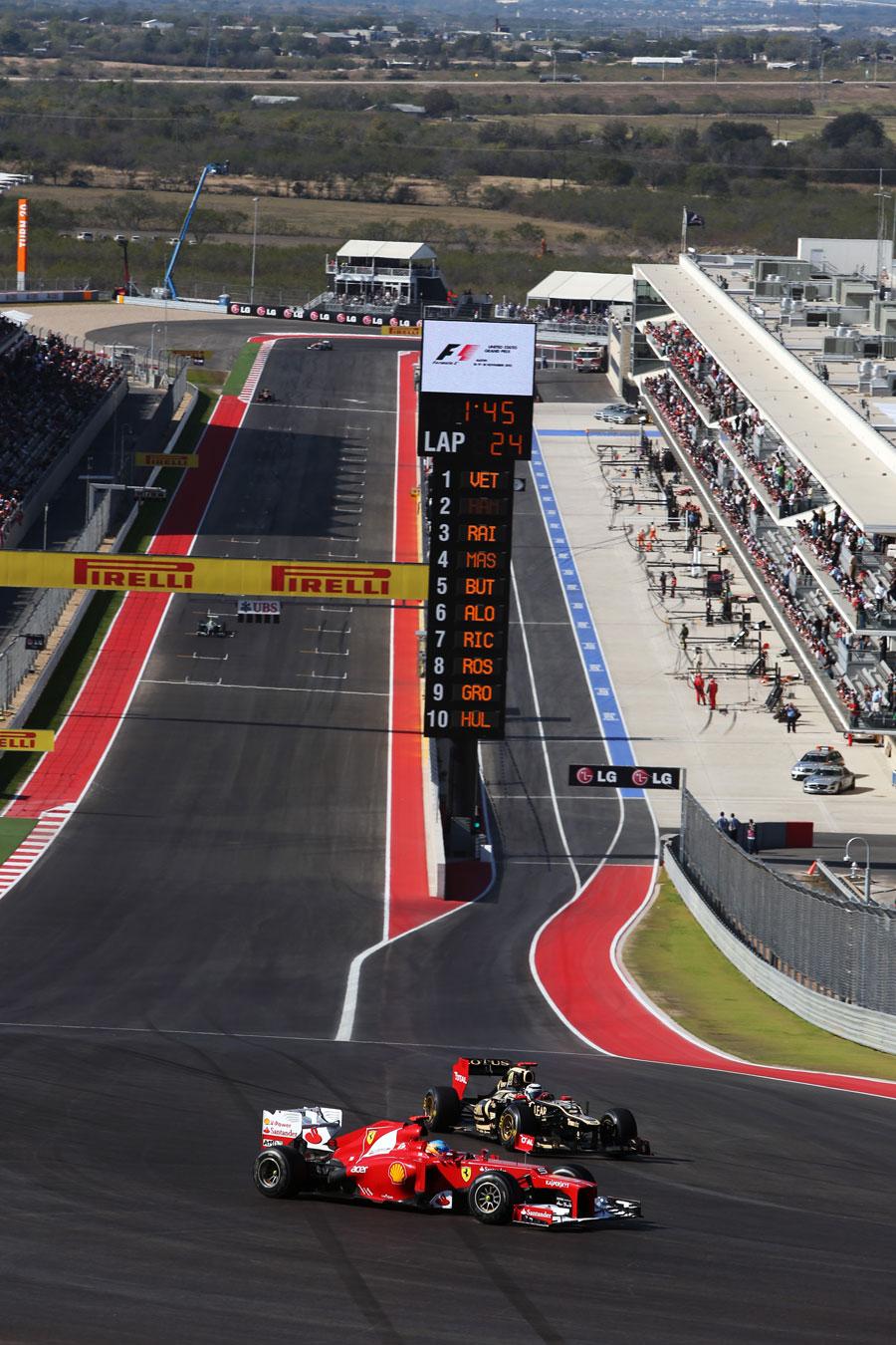 Kimi Raikkonen rejoins behind Fernando Alonso