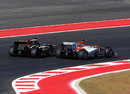 Kimi Raikkonen passes Nico Hulkenberg around the outside of turn three
