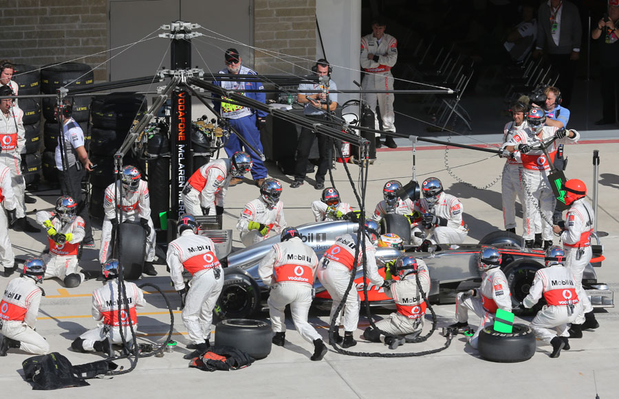 The McLaren team in action during a pit stop