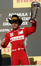 Fernando Alonso celebrates third place on the podium