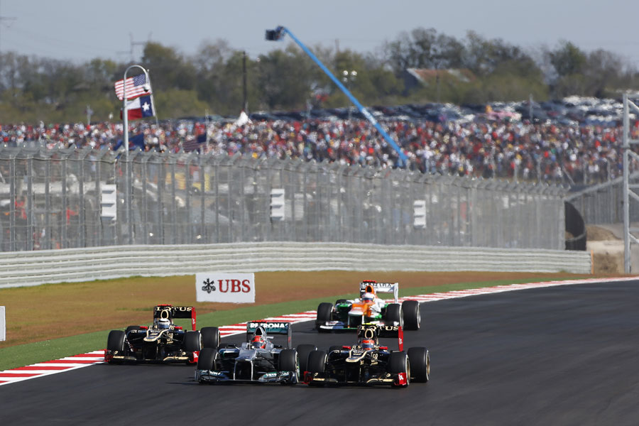 Romain Grosjean overtakes both Michael Schumacher and Kimi Raikkonen