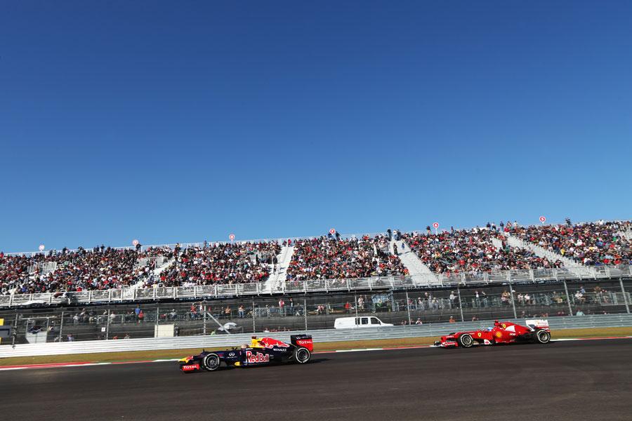 Sebastian Vettel leads Fernando Alonso on track