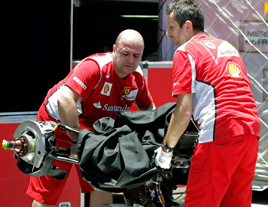 Crew members from the Ferrari team unpack on arrival at Interlagos