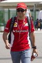 Felipe Massa walks through the paddock