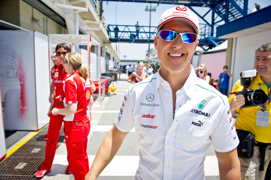 Michael Schumacher cuts a relaxed figure as he arrives for the final grand prix weekend of his career